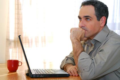 man at laptop thinking