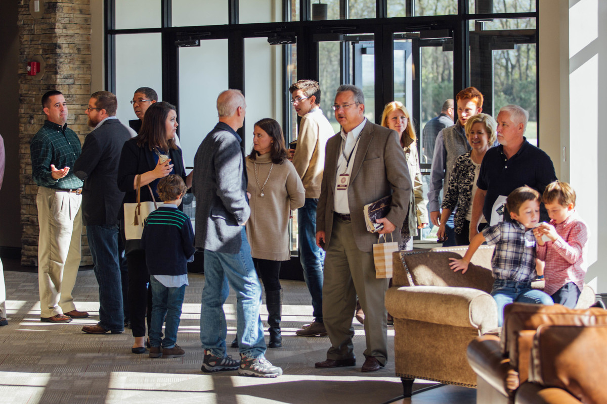 small church websites - picture of people in church lobby